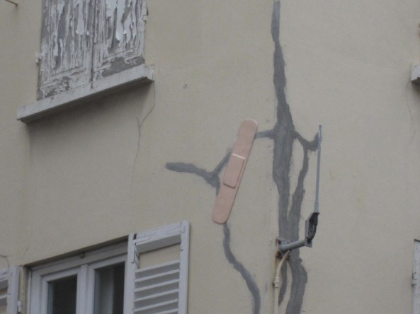 attention being paid to a hurting building in paris.